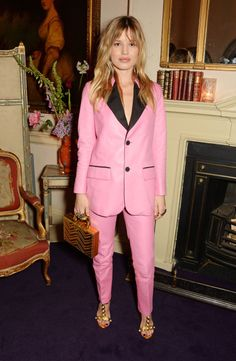 Seen here on Bianca Jagger's daughter Georgia May Jagger, the power suit is now as popular as ever — and this sharp cut comes in some equally powerful colors. Click through for more '80s fashion trends that are coming back today.