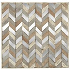 A wood and mirrored chevron pattern makes this piece unlike any other art you have on your wall. Zoey Wood & Mirror Chevron Wall Decor | Weekends Only Furniture and Mattress