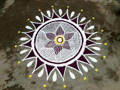 Freehand style kolam with maroon colour combination to look bright and beauty