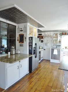 Farmhouse Kitchen Remodel - A Room with a View - Knick of Time.  Love her original hardwood floors!