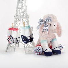 Plush pink poodle with baby socks for girls.