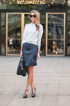 This New Yorker makes wearing a leather skirt look effortless.