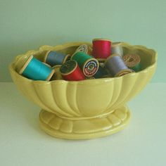 yellow planter with spools of thread