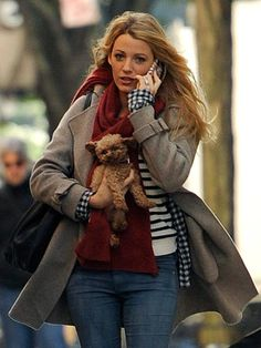 BLAKE LIVELY  The newlywed complements her engagement ring with her super-cute pooch
