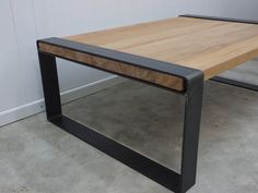 Coffee table with Raw steel and reclaimed timber