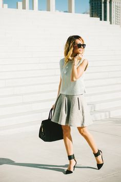 Classy - Meg wearing a Zara Top, French Connection Skirt and YSL Handbbag.