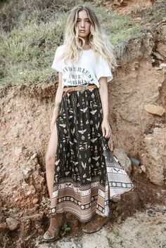 A high waisted maxi skirt featuring our signature leg loving splits and subtle pleats at the waist. Made in our hand drawn Phoenix print in soft earthy tones it