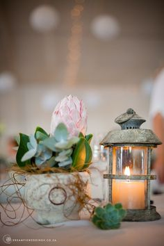 A laid-back South African Wedding Celebration at the Sea ♥ South African couple, Fiela and Biance, were married in a natural, laid-back and simply charming seaside celebration held at L'Agulhas in the Western Cape. Biance grew up in the South African South African Flowers, French Beach, South African Weddings, Celebrity Weddings, Flower Art, Seaside, Lanterns, Wedding Flowers, Candle Holders