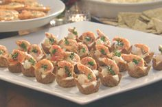 Garlic-Shrimp and cream cheese in baked cups made from Triscuits.  Fun small appetizers.  Makes 2 dozen.
