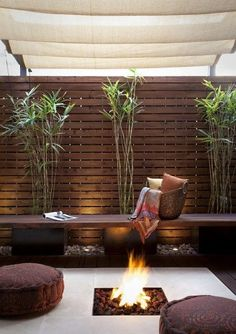 The use of browns cream here makes this a very cosy space - with a hint of the East in the bamboos floor cushions. The horizontal slatted screen adds a sense of space. - Gardening Life