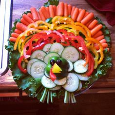 A veggie platter is a necessity, and of course a Thanksgiving veggie platter must be shaped like a turkey! :-)