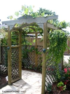 20+ Ways to create vertical interest in the garden with arbors, trellis, obelisks, and more. Arbor with hanging plant.