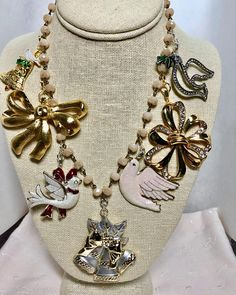 Christmas Gold Silver Vintage Bells Bows Doves Taupe Rosary Bead Assemblage Upcycled Bib Necklace Doodaba Christmas Necklace, Silver Christmas, Christmas Bows, Vintage Christmas, Tote Bags Handmade, Rhinestone Belt, Unique Necklaces, Taupe, Beaded Necklace