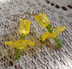 All Handmade with Green Czech Glass E-Beads and Yellow Acrylic Beads shaped like Tulip Flowers, these adorably appealing earrings are great for springtime! Connected with fish/french hook wire.  Also Available in Blue, Green, Pink and Purple Colors!