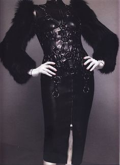 Alexander McQueen Autumn/Winter 2009-10 Ensemble, The Horn of Plenty Jacket of black leather, black fox fur, and silver metal; skirt of black leather Photographed by Sølve Sundsbø for Alexander McQueen: Savage Beauty