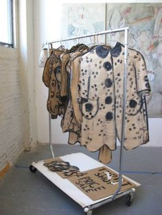 Craft paper clothing art installation.