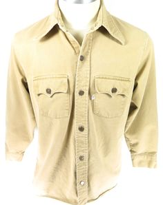 Vintage 70s Levis Big E white tab light brown men's work chore shirt jacket. Find more men's and women's authentic vintage clothing at The Clothing Vault.