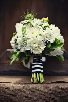 a mix of antique, creamy green hydrangeas, white scabiosa, cream ranunculus, fresh lavender, seeded eucalyptus, and rosemary @Carrington Brown