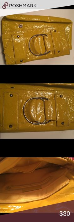 Hollow oversized clutch Very nice and vibrant yellow clutch . Painted material , new . Has a back zip and a zip in the inside , very spacious . Fun color for next spring . Chinese Laundry Bags Clutches & Wristlets