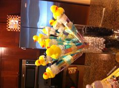 Baby shower favors and decor... Rub a dub dub baby in the tub. Tubes filled with bubble wash with rubber ducky in top and held together on a skewer.