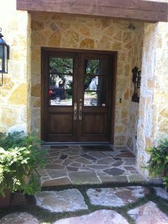 i looove stone wall with the wooden double doors <3
