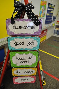 I know you're probably looking at the hanging chart (and it IS cute), but look in the background at the colorful strips of tape on the floor.  That's a less expensive alternative to pricey rugs for student seating on the floor.  Clever.