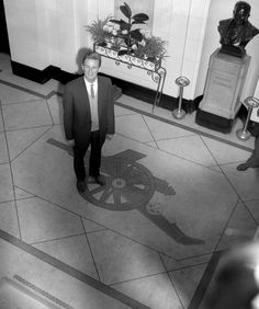 Arsenal's new signing George Eastham admires Highbury's marble entrance hall, 1960
