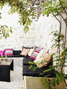 outdoor seating love these built in benches covered in comfortable cushions and stuccoed walls so simple
