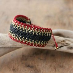 Wide burgundy, black and gold hand braided macrame bracelet. A statement jewelry piece, in a great color combination for your fall and winter wardrobe. Ideal to match with your holiday party outfits. This bracelet is braided with burgundy, black and gold waxed cord, using micro