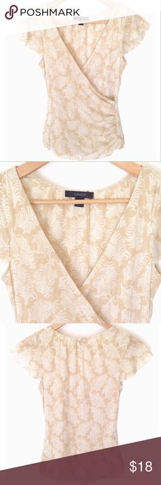 Express Flutter Sleeve Top This faux wrap top with flutter sleeves is feminine and flattering.  The fabric is stretchy and made up of a tan and cream leaf pattern with silver threading.  This is in like new condition. Express Tops Blouses