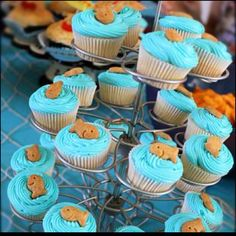 Mini cupcakes with honey or cinnamon goldfish crackers. Perfect for ocean/beach theme parties. I made these for my baby shower favors & boxed 'em up.