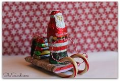 This Santa Candy Sleigh Christmas Craft is such a fun one to make with the kids and it also makes a great gift topper or teachers gift too!