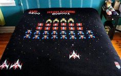 Wouldn't you want a retro gaming bedspread like this one?  Anyone up for some Space Invaders?
