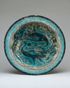 Bowl Date: late 12th–early 13th century Geography: Syria, Raqqa Culture: Islamic Medium: Stonepaste; underglaze painted and incised decoration
