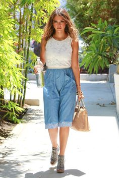 In Los Angeles, Jessica Alba sported a white, sleeveless lace top and denim culottes with a lace trim. [Photo by Bauer-Griffin/GC Images]
