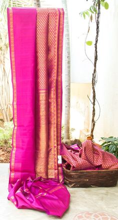 LUSTROUS PINK WITH SHOT OF PURPLE IS DELICATELY WOVEN IN FLORAL ALL OVER. THE PLAIN PINK BORDER AND DETAILED GOLD ZARI MOTIFS PALLU GIVES THE SAREE DAINTY FINISH.