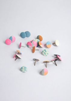 DIY: Reinvent office tacks by giving them a pretty, pastel makeover using nail polish and paint.
