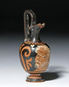 """Superb Miniature Greek Apulian Prochous, Chevron Group. /  Attributed to the Chevron Group, active in Southern Italy between 350 and 335 BCE, with examples by this group in the finest museums in the world including the Getty, Met, British Museum, and Louvre. Size: 3.625"""" H (9.2 cm)   Provenance: Ex-H. J. Berk collection; ex-private Illinois collection acquired in the 1980's. Estimate: $6,000 - $8,000"""