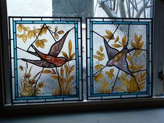 These two panels have been re-leaded and the birds have been repainted to complete the restoration.