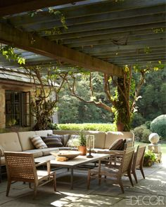 I like how the pergola dwarfs the roof to create a high ceiling... LookBook | Outdoor Room | ELLE Decor