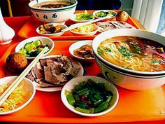 Lagman - Uzbek or Kazakh noodles floating in rich broth or soaked in a savory sauce with vegetables, meat & spices