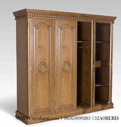 Jual Lemari Pakaian Ukir Jati 4 Pintu Jepara dengan 4 pintu, lemari material kayu jajati dengan warna finishing natural melamin, ukuran tinggi 200cm,.