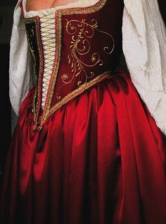 Venetian ca. 1535-This dress is based on a wonderful portrait by Paris Bordone. It shows a very unusual style, with front closed bodice not in Venetian ladder style. The front of the bodice also has ornamental golden embroidery. Created by Jenn Kluska
