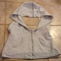 Open back Hoodie/very unique Great open back zips up in the front. And zipper on hoodie the zipper is multicolored iridescent very unique size medium Thread Tops Sweatshirts & Hoodies