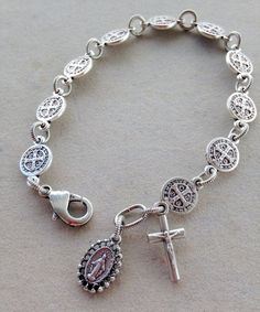 This simple, beautiful bracelet is made with 10 oxidized St. Benedict medals representing one decade of the rosary. Each medal is joined by a Rosary Bracelet, Rosary Beads, Beaded Bracelets, Rosary Bead Tattoo, Link Bracelets, St Benedict Bracelet, Diamond Cross Necklaces, Key Necklace, Catholic Jewelry