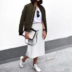 Bomber jacket and white sneakers