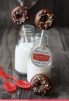 Mini donuts on a stick in a glass of milk~ what a GREAT idea for a party!