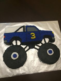 "Monster Truck Birthday Cake - Used a Wilton 1980s truck cake pan that I rented from a cake supply store. I cut out the tires and added my own using 6"" pans then decorated. I used black licorice to connect the wheels to the cab. My 3 year old loved it!"