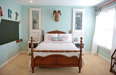 Love the paint color, Benjamin Moore 'galt blue' & the old doors framing the bed