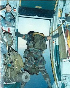 "Jumpmaster doing a ""Door Check"" just before putting out a load of Paratroopers."
